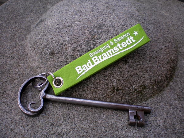 Schloss-Schlüssel mit Logoanhänger